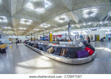 LONDON - SEP 27: Stansted airport baggage claim on September 27, 2013. Over 34 million passengers passed through Stansted in 2012. - stock photo