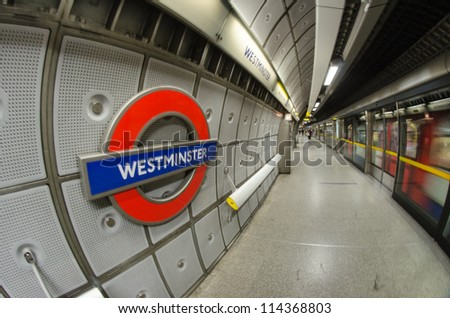 LONDON - SEP 28: Underground Westminster tube station in London on September 28, 2012. The London Underground is the oldest underground railway in the world covering 402 km of tracks. - stock photo