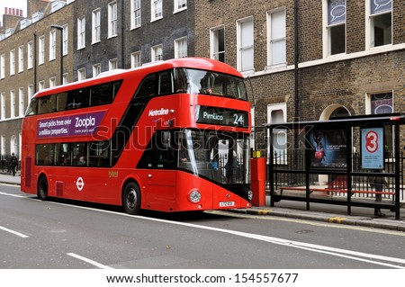 LONDON - SEPTEMBER 16. London's new Routemaster hybrid double deck bus with three doorways and two staircases accommodates 80 passengers; September 16, 2013, at bus stop in Bloomsbury, London, UK.  - stock photo