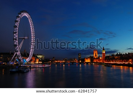 London skyline across the Thames from the London Eye to Westminster at night. - stock photo