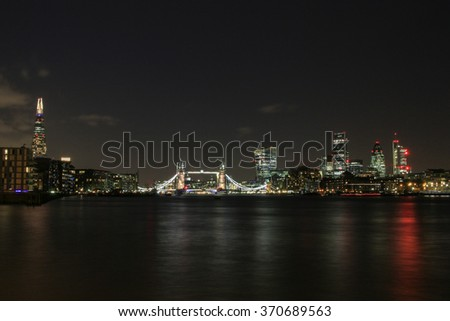 London skyline at night, showing the City of London, Tower Bridge and the Shard.  - stock photo