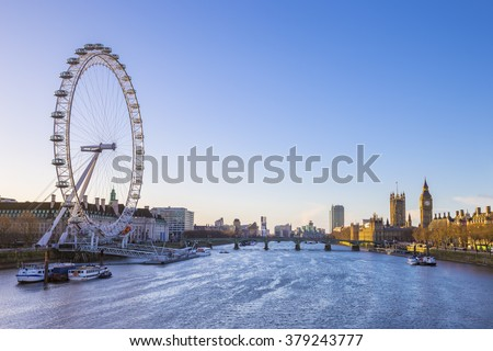London skyline view at sunrise with famous landmarks, Big Ben, Houses of Parliament and ships on River Thames with clear blue sky - London, UK - stock photo