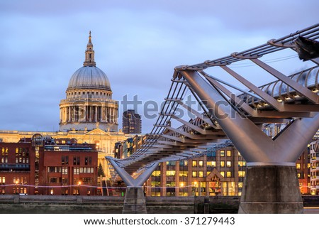 London skyline with St Paul's Cathedral and Millennium Footbridge at twilight in UK.  - stock photo
