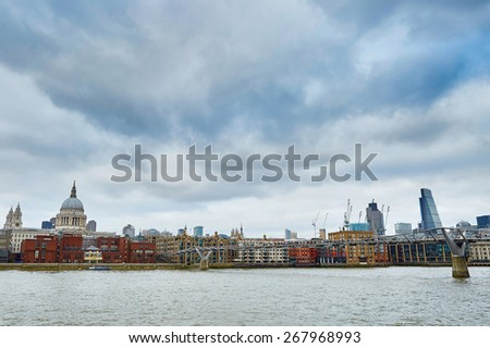 London skyline with St. Paul's cathedral, river Thames and the only pedestrian bridge in London �¢?? Millennium bridge - stock photo