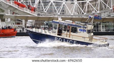 London speeding river police boat in action. - stock photo