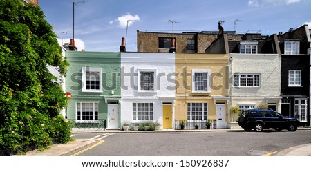 London street of small terraced houses. - stock photo