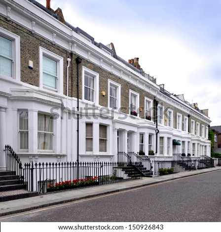 London street of 19th century Victorian terraced houses, without parked cars. - stock photo