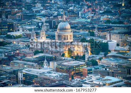 London. Stunning aerial view of St. Paul Cathedral and city skyline at dusk. - stock photo