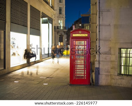 London telephone booth at night at Soho, London, United Kingdom, Europe - stock photo