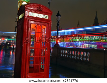 London Telephone box at night with streaming vehicle headlights - stock photo