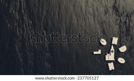 london text and big ben icon on black stone relief surface - stock photo