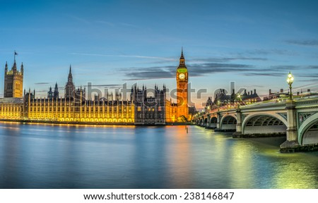London, the House of Parliament, with the Big Ben and Westminster bridge at dusk - stock photo