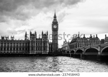 London - The Houses of Parliament, Westminster Bridge and the Big Ben under thick clouds - stock photo