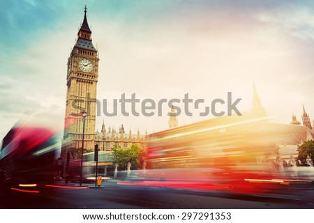 London, the UK. Red buses in motion and Big Ben, the Palace of Westminster. The symbols of England in vintage, retro style - stock photo