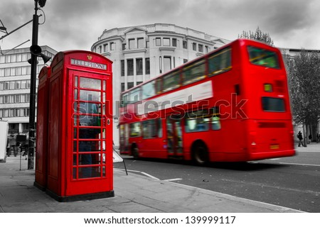 London, the UK. Red phone booth and red bus in motion. English icons - stock photo