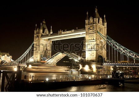 London Tower Bridge Open boat Night - stock photo