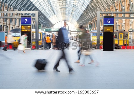London Train Tube station Blur people movement in rush hour, at King's Cross station, England, UK  - stock photo