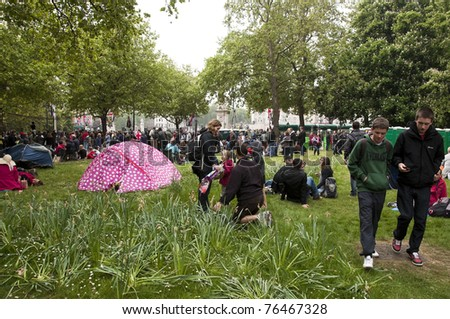 LONDON, UK - APRIL 29: A pink tent and the crowd near Buckingham Palace during Prince William and Kate Middleton wedding, April 29, 2011 in London, United Kingdom - stock photo