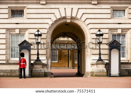 LONDON, UK - APRIL 2: A royal guard at Buckingham Palace which will be the starting point of the royal wedding procession to be held on Friday 29th April, April 2, 2011 in London, United Kingdom - stock photo