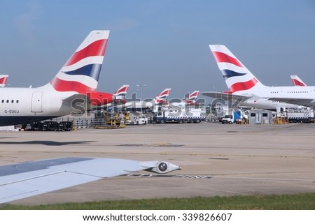 LONDON, UK - APRIL 16, 2014: British Airways Airbus A320s and A380 at London Heathrow airport. BA operates fleet of 283 aircraft (largest in the UK) and is largest operator of 747 with 55 aircraft. - stock photo