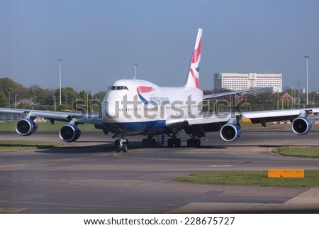LONDON, UK - APRIL 16, 2014: British Airways Boeing 747 at London Heathrow airport. BA operates fleet of 283 aircraft (largest in the UK) and is largest operator of 747 with 55 aircraft (2014). - stock photo
