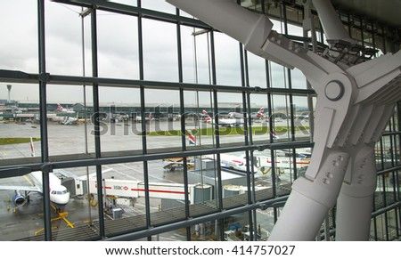 LONDON, UK - APRIL 7, 2016: British Airways plane in the Heathrow airport terminal 5 getting ready to depart - stock photo