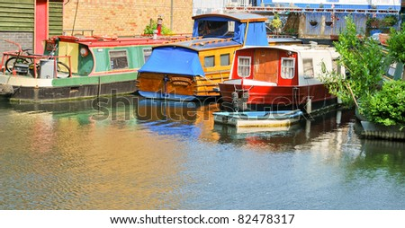 LONDON, UK - APRIL 30: Details of the traditional narrowboats, decorated with flags and Barge Ware, moored in Little Venice, Paddington, for the annual Canalway Cavalcade. April 30, 2011 in London UK. - stock photo