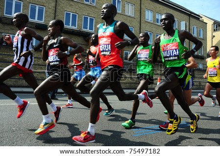 LONDON, UK - APRIL 17, 2011 - Emmanuel Mutai (r) runs with the main group of marathones in the Virgin Maraton April 17 in London - stock photo