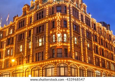 LONDON, UK - APRIL 18 2016: Harrods store illumination at dusk. - stock photo