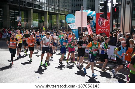 LONDON, UK - APRIL 13, 2014: - London Marathon in Canary Wharf aria, massive sport event for professionals and amateurs sportsmen, Champions League    - stock photo