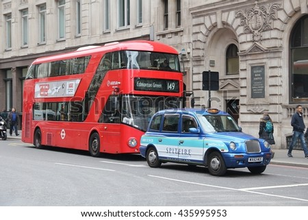 LONDON, UK - APRIL 22, 2016: People ride New Routemaster bus behind a taxi cab in City of London. The hybrid diesel-electric bus is a new, modern version of iconic double decker. - stock photo