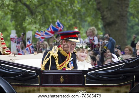LONDON, UK - APRIL 29: Prince Harry rides in a carriage on his way to Buckingham Palace after  the royal wedding of Prince William and Catherine Middleton on April 29, 2011 in London, UK - stock photo