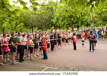 LONDON, UK- APRIL 17: Runners gather at one of the starting lines in Greenwich Park, for the annual London Marathon on April 17, 2011 in London UK. - stock photo