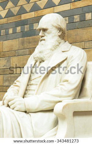 LONDON, UK - APRIL 28 2013: Statue of Charles Darwin in the Main Hall at the Natural History Museum. With over 70 million specimens on display it is one of Londons most popular visitor attractions. - stock photo