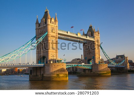 LONDON, UK - APRIL15, 2015: Tower bridge in sunset. City of London, south bank of river Thames - stock photo