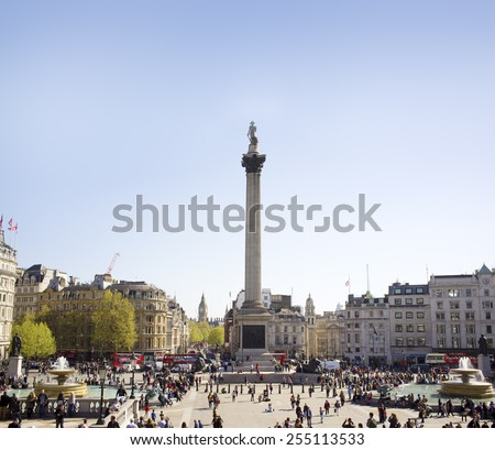 LONDON, UK - APRIL 16, 2014: Trafalgar Square is a public space and tourist attraction in central London, built around the area formerly known as Charing Cross. - stock photo