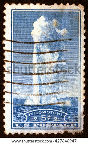 London, UK, April 5 2008 - Vintage 1934 United States of America cancelled postage stamp showing an image of the Old Faithful geyser at Yellowstone Park - stock photo