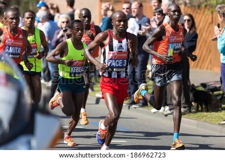 LONDON, UK - APRIL 13, 2014 - Wilson Kipsang Kiprotich, Geoffrey Mutai and Tsegaye Kebede run with the main group of marathoners at km. 15 in the Virgin Maraton April 13 in London - stock photo