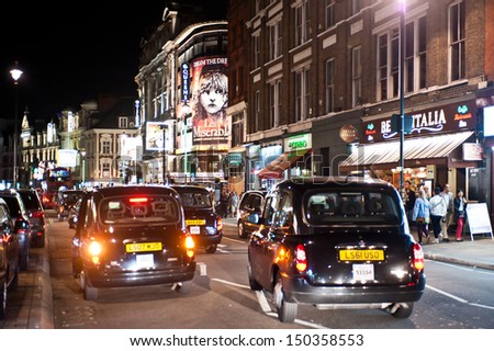 LONDON, UK - AUG 16: People and traffic fill the streets of Soho in London on August 16, 2013. From pubs to upmarket bars, nightclubs to a vibrant gay scene, soho is a popular night area in the city. - stock photo