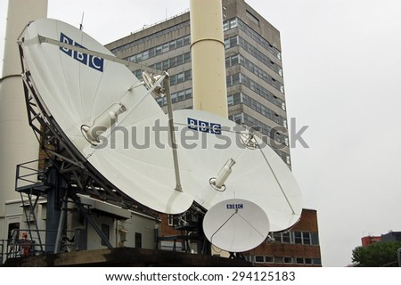 LONDON, UK - AUGUST 23, 2007: A cluster of satellite dishes outside BBC Television Centre in Shepherd's Bush, West London.  - stock photo