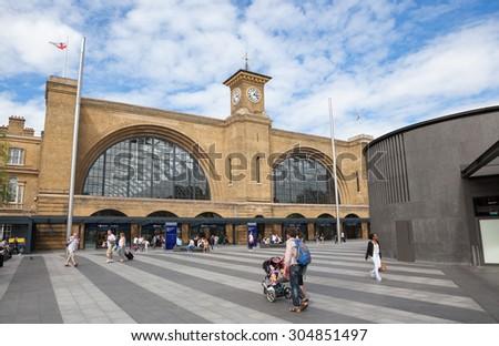LONDON, UK - AUGUST 9, 2015: Kings Cross Railway Station London with people walking outside. - stock photo