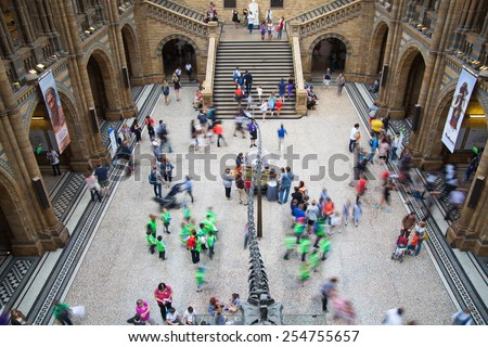 LONDON, UK - AUGUST 11, 2014: People in National History Museum, is one of the most favourite museum for families in London. - stock photo