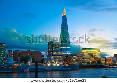 LONDON, UK - August 11, 2014: Shard of glass and office buildings in twilight. View form tower of London - stock photo