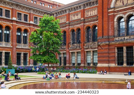 LONDON, UK - AUGUST 24, 2014: Victoria and Albert Museum historical building. V&A Museum is the world's largest museum of decorative arts and design. - stock photo