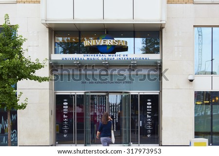 LONDON, UK - AUGUST 17: Woman approaching entrance of Universal Music Group International building in High Street Kensington. August 17, 2015 in London. - stock photo