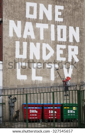 """LONDON, UK / CIRCA AUGUST 2008 - Famous Impressive graffiti made by Banksy, which was destroyed. """"One nation under CCTV"""". Near Oxford street. London - stock photo"""