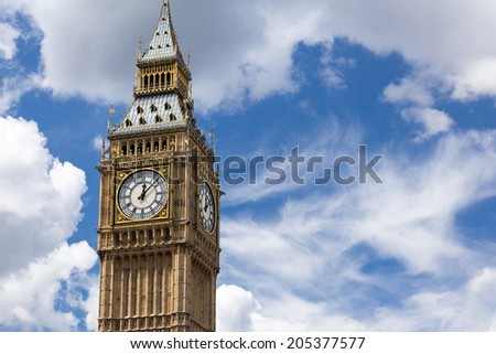 LONDON, UK / CIRCA JULY 2014 - Wide view of the famous Elizabeth tower hosting the Big Ben great bell in Central London on a summer day with dramatic clouds in the background - stock photo