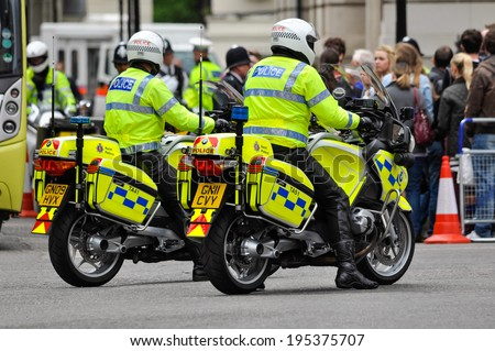 LONDON, UK - CIRCA JUNE 2012: Two police officers on their motorbikes. - stock photo