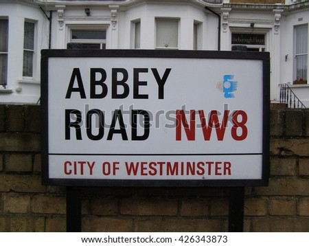 LONDON, UK - CIRCA NOVEMBER 2009: Abbey Road street sign in front of the EMI recording studios, where the Beatles recorded most of their albums - stock photo