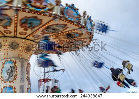 LONDON, UK - DECEMBER 9 : Carousel at Winter Wonderland Hyde Park in London on December 9, 2012. Unidentified people. - stock photo